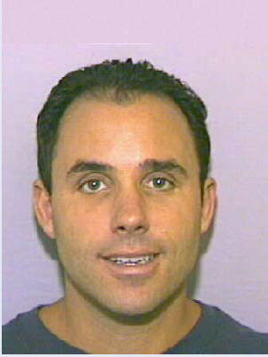 Снимка след ареста на Ливайн през 1991 г. в САЩ