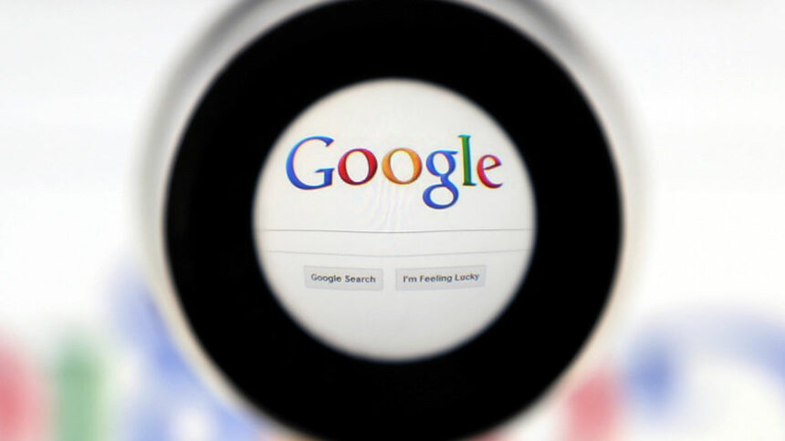 FILE PHOTO: A Google search page is seen through a magnifying glass in this photo illustration taken in Brussels May 30, 2014. REUTERS/Francois Lenoir/File Photo